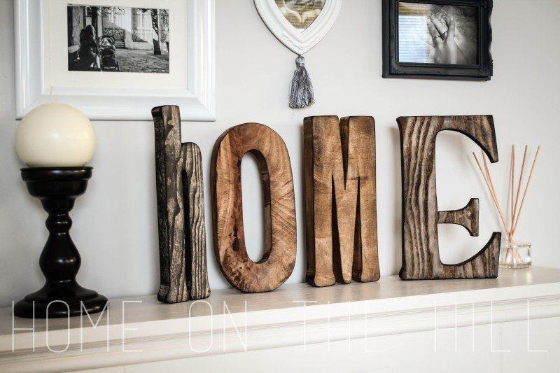 drewniane litery, napis z drewna. stylowy salon